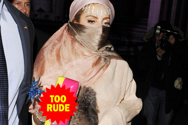 Attention seeker? Lady Gaga teams a burqa with a clutch that says the C-word