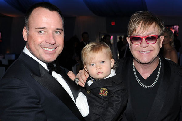 Elton and David with their first child Zachary Jackson Levon