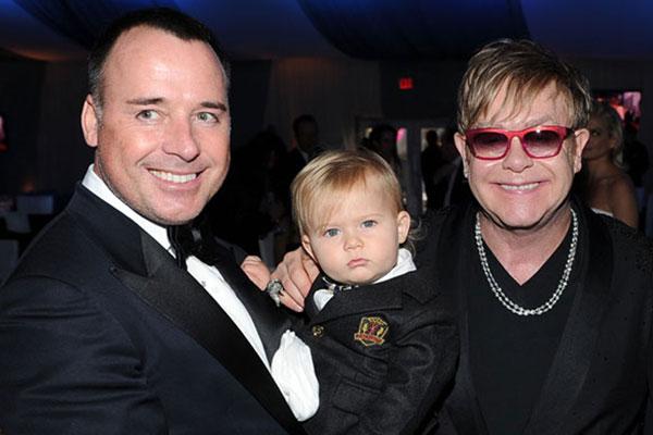 Elton and David with their first child Zachary Jackson Levon