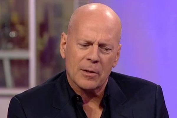 Watch: Bored? Drunk? Bruce Willis's bizarre mumbling interview