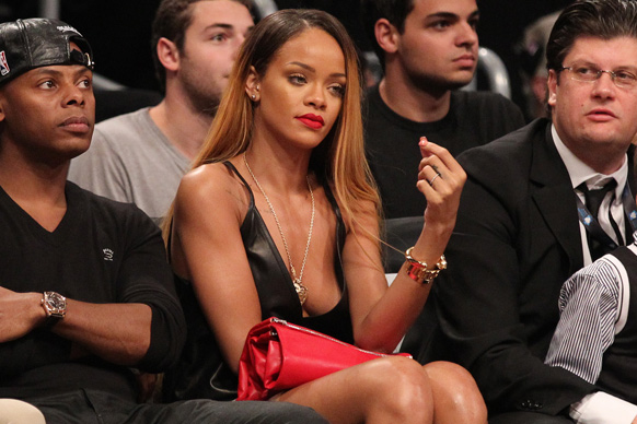 RiRi was so wrapped up in the basketball game in front of her that she didn't even notice her own balls trying to escape the net.