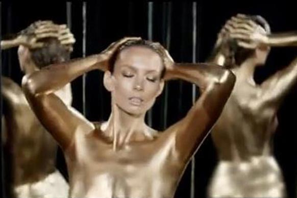 Ricki-Lee is the latest popstar to cover herself in body paint (and only body paint!) for the sake of a music video. Let's take a look back in the pop archives at other daring and baring singers.