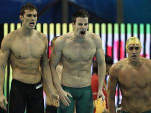 Matthew Targett, James Magnussen and Matthew Abood of Australia cheer on teammate Eamon Sullivan in the men's 4x100m freestyle relay. (Getty)
