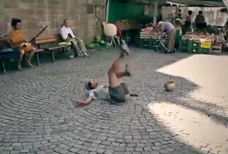 <b>A mystery busker has been compared to the world's best freestyle footballers after the emergence of a video showcasing his skills.</b><br/><br/>Filmed as he performed to live music, the busker appears to combine gymnastics and dance as he effortlessly moves a football around his body whilst never letting it touch the ground.<br/><br/>The video comes less than a month after the official world freestyling championships, won by Poland's Szymon Skalski. Compare the two with others who have caught our attention...