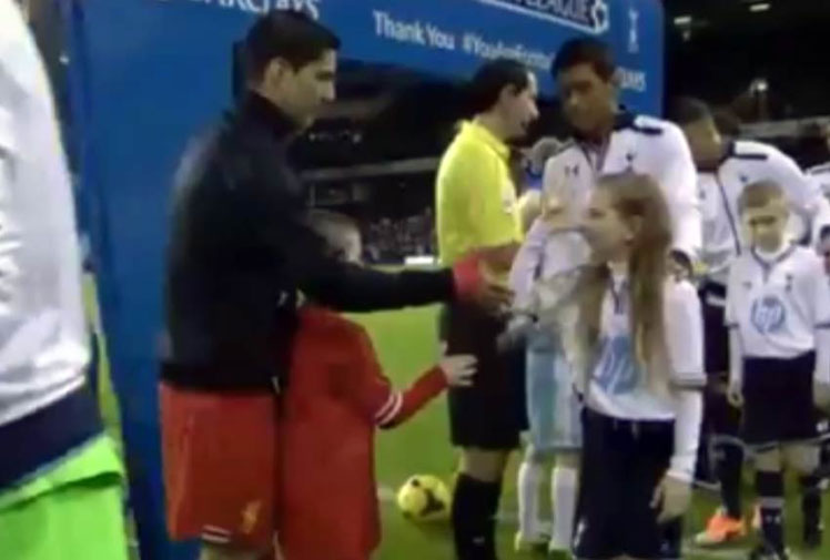 <b>A mascot has provided the only bright moment for Tottenham in their loss to Liverpool by snubbing Reds captain Luis Suarez in the pre-match handshakes. </b><br/><br/>The young girl chose to wiggle her fingers with her thumb on her nose instead of shaking hands with the Uruguayan master. <br/><br/>Suarez and Spurs rival Paulinho were all smiles as they watched the girl pull off the joke. <br/><br/>The handshake was full of irony given Suarez's snub of Manchester United's Patrice Evra after his ban for racist abuse last year. <br/><br/>Click through to watch the funny moment. <br/>