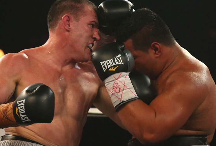 <b>Rugby league star Paul Gallen has made an exhilarating professional boxing debut, climbing off the canvas to stop Herman Ene-Purcell in two frantic rounds.</b><br/><br/>After being dropped in the first round, Gallen pounded his rival in the second, forcing the referee to stop the fight.<br/><br/>However the action didn't end there as the two fighters exchanged several more blows. <br/><br/>Gallen was on the undercard to Daniel Geale, who schooled Garth Wood. (Getty Images)<br/><br/><br/>