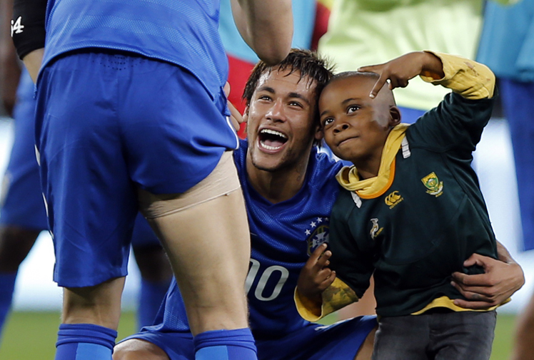 <p>Pitch invasions don't normally end well, but this one is sure to make you smile.</p><br/><p>A young soccer fan somehow made his way onto the field during Brazil's match against South Africa at Soccer City stadium in Soweto on Wednesday.</p><br/><p>Security guards made a B line for the youngster, but Brazilian superstar Neymar intervened, grabbing the boy to introduce to the rest of the team and pose for photos.</p><br/><p>Scroll through for some pitch invasions that didn't end so well.</p>