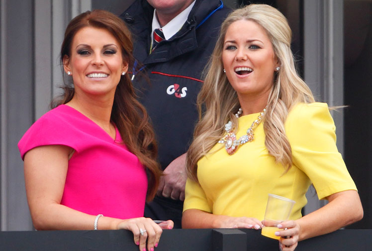 <b>A member of the royal family and one of football's leading WAGs stole the show on the opening day of the Grand National festival in England.</b><br/><br/>Collette Rooney, the wife of Manchester United star Wayne, certainly stood out in a bright pink dress while Princess Anne endulged her passion for racing as the festival got underway at Aintree in Liverpool.<br/><br/>On the track Silviniaco Conti won the Bowl in the jumps action while racegoers certainly took advantage of the warmer weather in the northern spring.<br/>