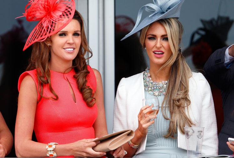<b>The glamour stakes went up a notch on the second day of the Grand National festival in England, the traditional Ladies Day. </b><br/><br/>Women flocked to Aintree in Liverpool in a variety of outfits, with some fans electing to go with bright colours while others went for the simple black or white number. <br/><br/>On the track, Ma Filleule cruised to victory in the Crabbies Topham Chase. <br/>