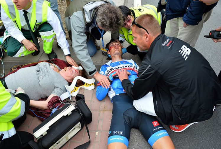 <b>An elderly cycling fan is fighting for her life in hospital after a sickening crash at a prestigious road race.</b><br/><br/>The woman was standing on a traffic island at the Tour of Flanders when she was hit by Garmin-Sharp rider Johan Vansummeren.<br/><br/>Both were rushed to hospital and though Vansummeren has been cleared of serious injury, the spectator remains in intensive care.<br/><br/>Fans and officials are often in the line of fire during road races, as these videos prove.<br/><br/><br/><br/>