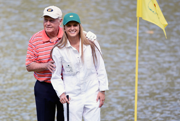 <b>Tennis star Caroline Wozniacki has unveiled a pink hairstyle while caddying for her fiancé Rory McIlroy during the Masters par three contest at Augusta. </b><br/><br/>Wozniaki attracted attention for more than just her hair colour, with the former tennis world No1 draining a long putt on the ninth hole. <br/><br/>Matt Jones was responsible for the major highlight after becoming the first Australian on debut at Augusta National to score a hole-in-one.<br/><br/>American Ryan Moore has the task of ending the curse after taking out the event, with no previous winner of the par-three going onto claim victory in the Masters.<br/><br/>