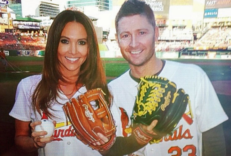 <b>Michael and Kyly Clarke have shared an historic moment in the United States after being invited to throw the first pitch at a Major League Baseball game.</b><br/><br/>The couple was invited to take part in the ceremony at the match between St Louis Cardinals and Chicago Cubs at Busch Stadium and stunned onlookers when they took up their positions.<br/><br/>Instead of striding to the mound, Australia's cricket captain instead played the role of catcher behind home plate, leaving the real honour of throwing the first pitch to Kyly.<br/><br/>