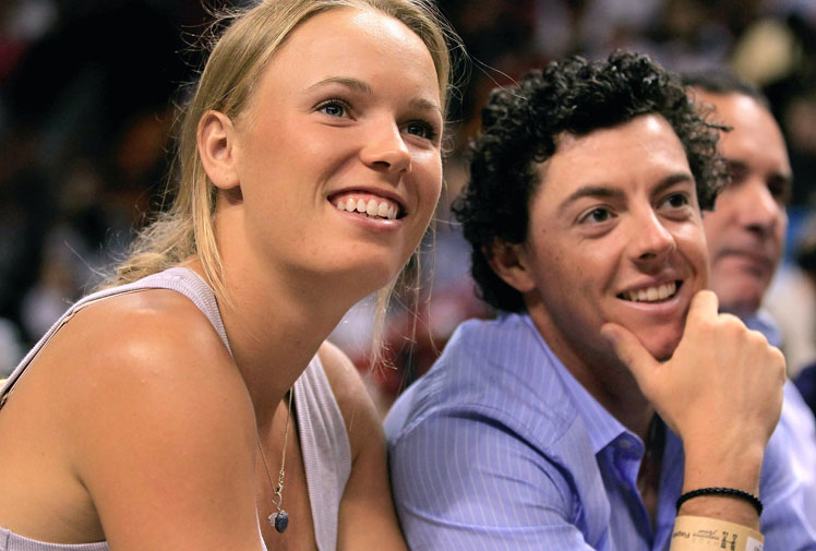<b>An emotional Rory McIlroy has announced he has broken off his engagement and split with Danish tennis star Caroline Wozniacki, only days after sending out their wedding invitations.</b><br/><br/>The 25-year-old Northern Irishman and two-time major champion said the issuing of the invitations had made him aware that he was not ready for marriage.<br/><br/>Their shock split comes just weeks after they were pictured kissing and giggling together at the US Masters.