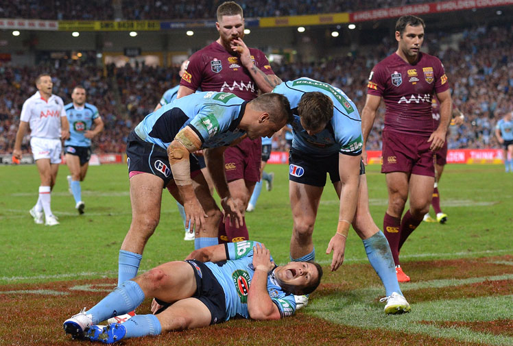 <b>Queensland and NSW as well as a host of NRL clubs have been left to count the cost of a brutal Origin opener. </b><br/><br/>Maroons halfback Cooper Cronk was the first star to suffer an injury after breaking his arm in the 10th minute, while skipper Cameron Smith sustained ankle ligament damage.<br/><br/>The Blues were not spared with Brett Morris dislocating his shoulder, brother, Josh, suffering a suspected knee ligament tear and captain Paul Gallen sustaining a neck injury. Anthony Watmough also suffered a suspected torn bicep. <br/><br/>Click through to re-live the brutality and the bravery of the fierce Origin opener. <br/><br/><br/><br/><br/>