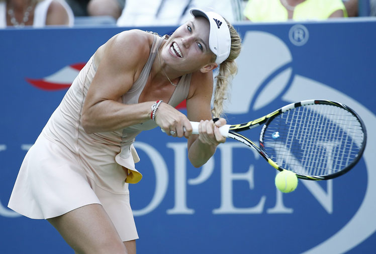 <br/><b>She's as famous for her good looks and flowing blonde hair as her on court proficiency.</b> <br/><br/>But Danish tennis beauty Caroline Wozniacki found the downside of her long locks in what can only be described as the ultimate bad hair day at the US Open.<br/><br/>In a comical incident, the world No. 10 was left all tied up when her ponytail became tangled mid-point against Belarusian Aliaksandra Sasnovich.<br/><br/>Wozniacki missed the return to lose the point but at least won the match - 6-3, 6-4.<br/><br/>