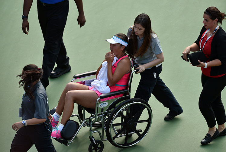<b>The US Open has seen a day of drama after China's Peng Shuai departed her semi-final in a wheelchair.</b><br/><br/>China's Shuai was forced to abandoned her match trailing Caroline Wozniacki 7-6 (7-1) 4-3 after twice collapsing with cramp.<br/><br/>Her tearful exit provoked a verbal barrage from tennis great John McEnroe who labelled the moment as a 'black eye'. <br/><br/>But Shuai's dismay was Wozniacki's joy, the dramatic end to the match a stunning mixture of misery and ecstasy ...<br/>