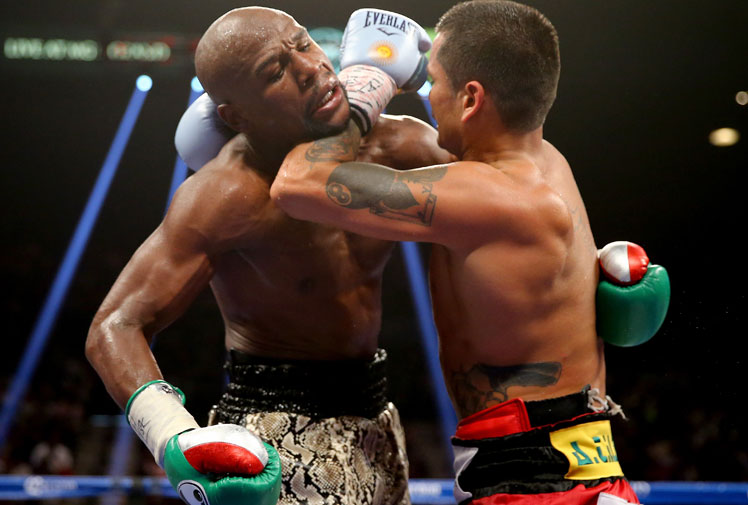 <b>Champion boxer Floyd Mayweather has claimed his 47th straight fight by beating Argentine slugger Marcos Maidana in a bad-tempered rematch that was marred by bite claims.</b><br/><br/>Mayweather, who hasn't lost a fight since the 1996 Olympics, successfully defended his World Boxing Association and World Boxing Council welterweight belts and the WBC junior middleweight belt in a unanimous points decision.<br/><br/>But the bout was engulfed in controversy as Mayweather accused Maidana of biting him.<br/>