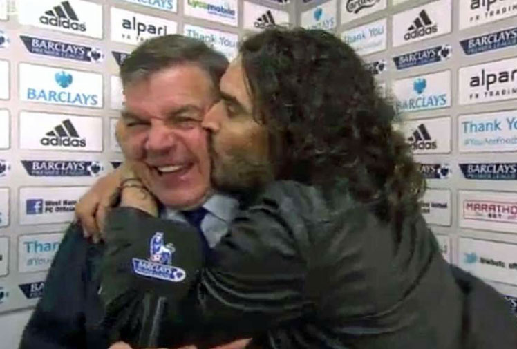 "<b>West Ham United are on the way up in the English Premier League and no-one's more happy than comedian Russell Brand.</b><br/><br/>West Ham pulled off the shock of the round after upsetting Manchester City and Hammers devotee Brand just couldn't contain his excitement.<br/><br/>Invading Hammers boss Sam Allardyce's interview, the star landed a number of kisses on the shocked coach before telling the reporter: ""Give the man the credit he deserves!""<br/><br/>Check out the joyous moment and other weird, strange and just plain awkward interviews."