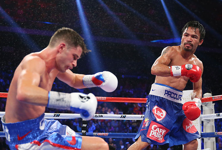 <b>Filipino icon Manny Pacquiao comprehensively dismantled American Chris Algieri to retain his WBO welterweight title at the Cotai Arena in Macau on Sunday.</b><br/><br/>Algieri, the unbeaten WBO light welterweight champion, was outclassed from the start with Pacquiao dropping him to the canvas six times during the 12 rounds. <br/><br/>Pacquiao won an overwhelming unanimous decision: 119-103, 119-103, 120-102 on the judges' cards in the southern Chinese city.