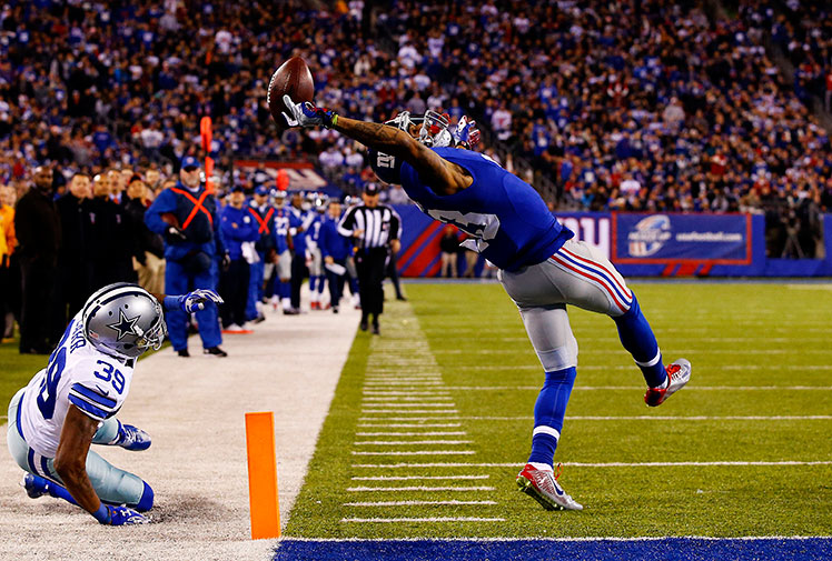 "<b>There is no shortage of unbelievable catches in the NFL, but a New York Giants star may have taken the greatest of them all. </b><br/><br/>Footage of the grab shows Odell Beckham Jr wrestle away from his Cowboys opponent and arch his back to take the pass above his head with just his right hand. Incredibly, Beckham managed to stay on his feet and score a touchdown. <br/><br/>The catch was so good it had veteran commentator Cris Collinsworth uttering, ""that may be the greatest catch I've ever seen.""<br/> <br/>Click through and decide for yourself. <br/>"
