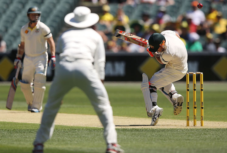 <b>Adelaide Oval was a sea of emotion as the First Test between Australia and India got underway.</b><br/><br/>Before the match fans honoured Phillip Hughes with 63 second of applause in a tribute to his final score when he was fatally injured after being struck by a bouncer at the SCG. <br/><br/>Hughes' Test number - 408 - was painted onto Adelaide Oval, while Australian players also had the number stitched onto their shirts under the coat of arms and there was a mountain of flowers and cricket bats paying respect to the late batsman at a memorial shrine.