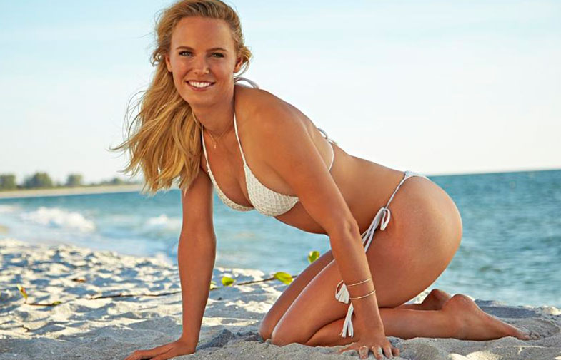"""<b>Caroline Wozniacki has sent Rory McIlroy a provocative reminder of what he's missing in a racy photoshoot with Sports Illustrated.</b><br/><br/>The former world number one of women's tennis has shared a series of images with her fans online that show her posing in a variety of white swimsuits.<br/><br/>They come nine months after her shock split from golf's world number one, who called off their engagement just days after they sent out wedding invitations.<br/><br/>McIlroy dumped his then-fianceé over the phone and issued a press release saying """"the problem is mine""""."""