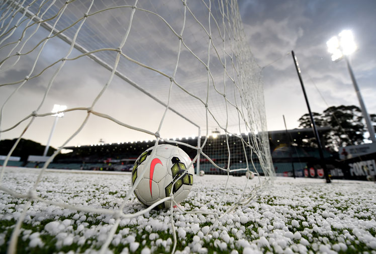 <b>Mother Nature has thrown a spanner into Anzac Day sporting matches after a spectacular storm swept across parts of Sydney.</b><br/><br/>The storm, which lasted no more than 10 minutes, dumped hail and torrential rain and forced disruptions to both the NRL and the A-League.<br/><br/>In the clash between the Roosters and the Dragons, play was halted due to the threat of lightning and hail while in Parramatta, the Wanderers and the Glory game was delayed as the pitch was turned into a winter wonderland.<br/>