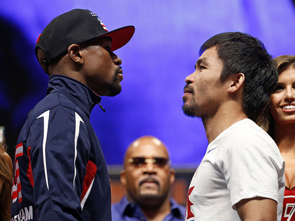 Mayweather, Pacquiao weigh-in for 'super fight'