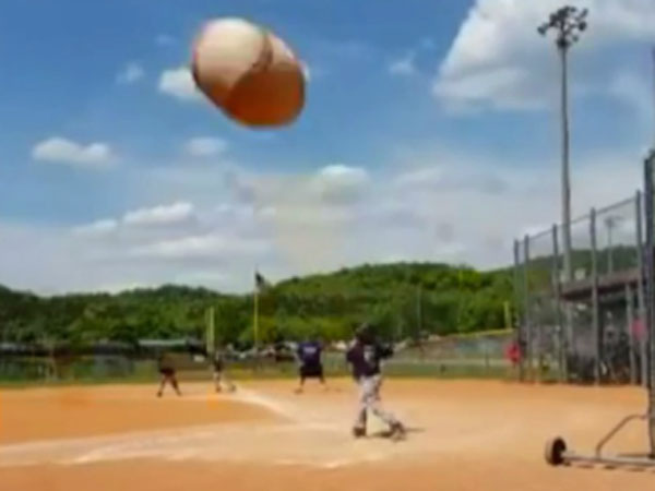 Baseballer shanks shot into mum's camera