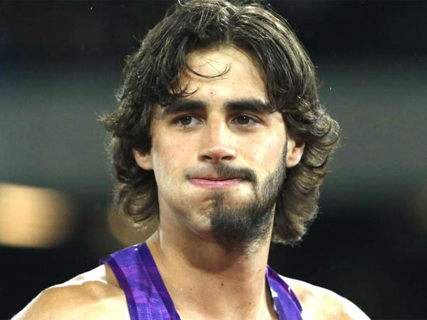 High jumper sports weird half beard
