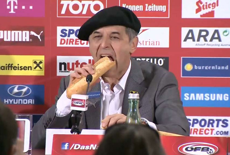 <b>Austrian football coach Marcel Koller turned a post-match conference into a culinary experience when he broke bread with a number of journalists.</b><br/><br/>The 54-year-old fronted the press after guiding the country to Euro 2016 in France following a 4-1 victory over Sweden.<br/><br/>Wearing a beret and sitting behind a baguette, Koller made a short statement before breaking the loaf and enjoyed a tasty bite. <br/><br/>See how the hungry coach ranks among our gallery of bizarre sport interviews.