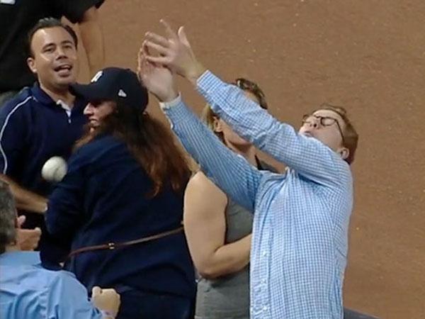 Clumsy baseball fan fumbles shot at fame