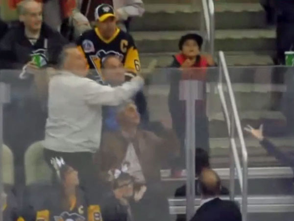 Man steals trophy puck from young boy