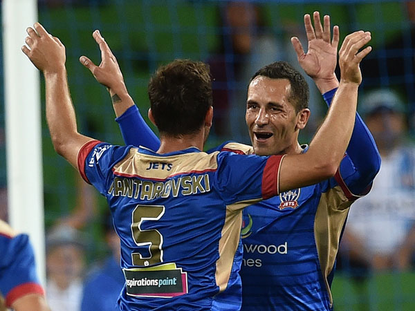 The Newcastle Jets celebrate a goal in the 3-2 win. (AAP)