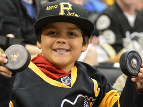 Dastardly hockey fan poaches child's puck