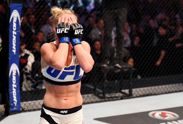 <b>Holly Holm has caused the upset of the year after knocking out the previously undefeated Ronda Rousey in their bantamweight title fight at UFC 193.</b><br/><br/>Holm claimed the victory after delivering a brutal kick to the face early in the second round that forced the referee to call time.<br/><br/>The knockout stunned the crowd at at Etihad Stadium in Melbourne with the previously undefeated Rousey expected to reclaim her crown.<br/><br/>Re-live one of the biggest shocks in UFC history ...<br/><br/><br/><br/>