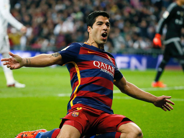 Luis Suarez celebrates one of his two goals. (AAP)