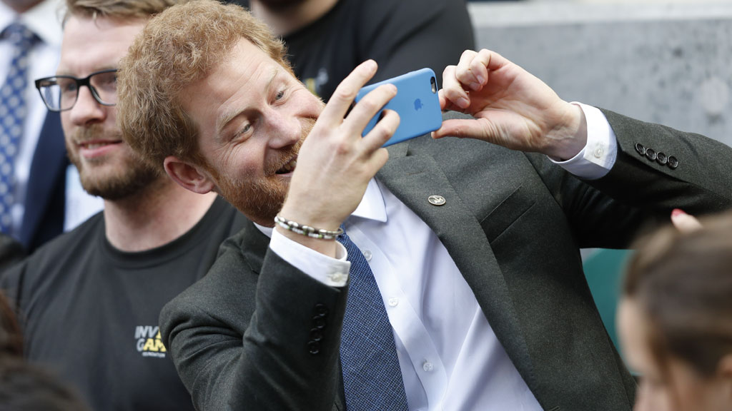 Prince Harry on his phone