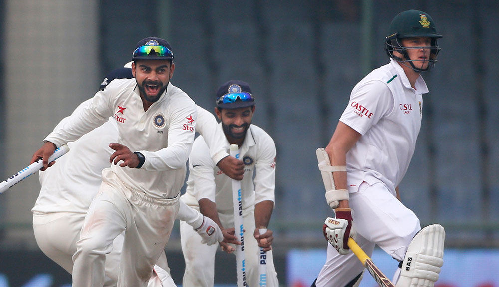 Virat Kohli celebrates the Test win after Ravi Ashwin removed Morne Morkel. (AAP)