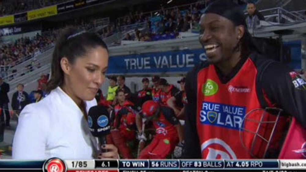 Chris Gayle laughs during the interview with Mel McLaughlin.