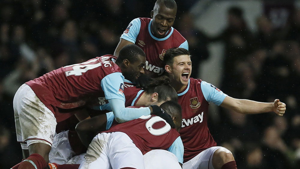 The Hammers celebrate Angelo Ogbonna's winner. (AAP)