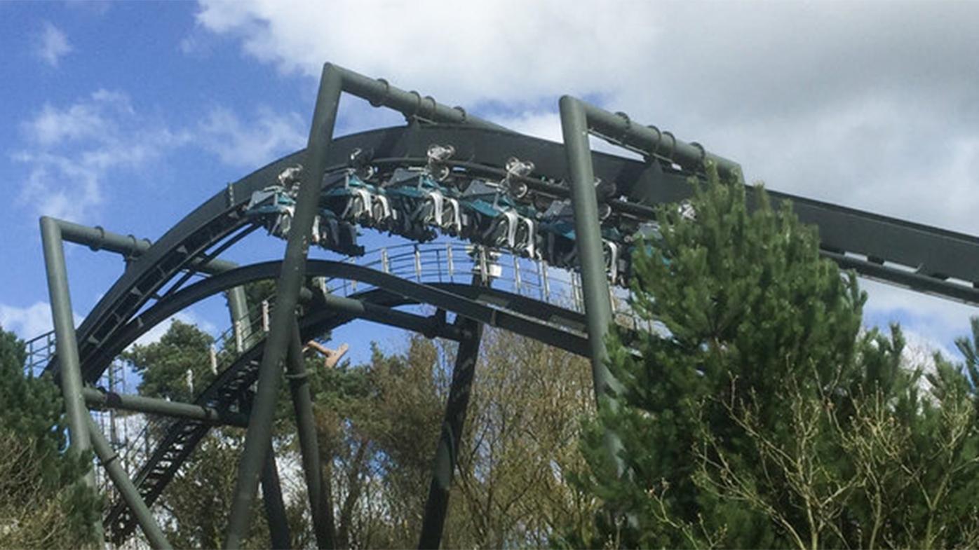 Riders left hanging upside down when roller coaster 'floods'
