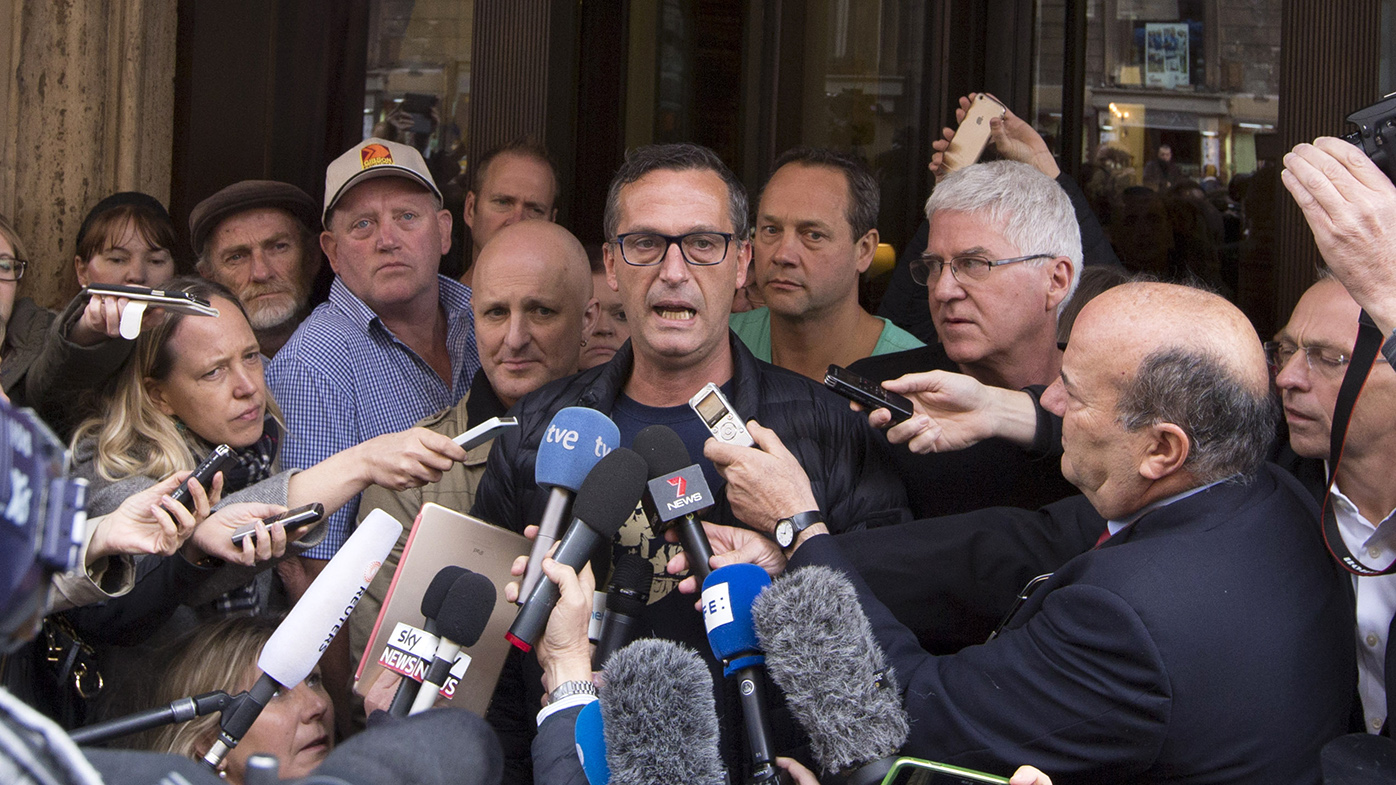 David Ridsdale, center, flanked by other members of the Australian group of relatives and victims of priestly sex abuses, talks to reporters outside of the Quirinale hotel after their meeting with Australian cardinal George Pell, in Rome. (AAP)