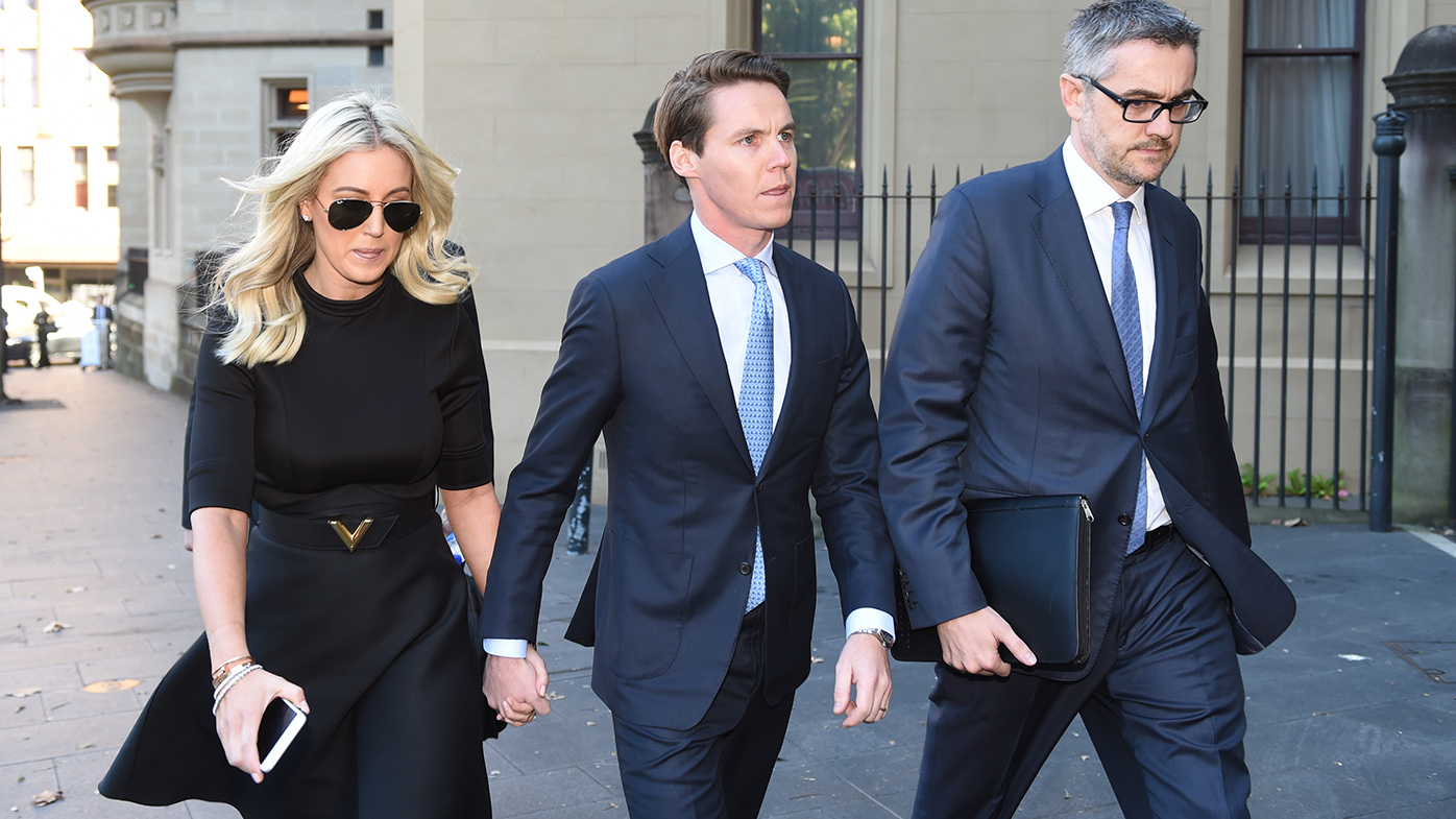 Jackeno heading to court with husband Oliver Curtis (centre). (AAP)