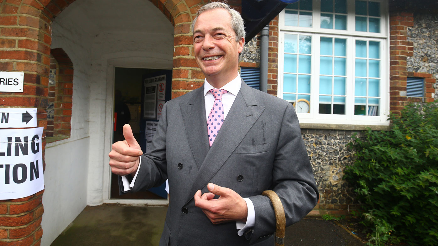 Ukip party leader Nigel Farage, a prominent member of the leave campaign, gestures as he arrives to cast his vote in Biggin Hill, south eastern England. (AAP)