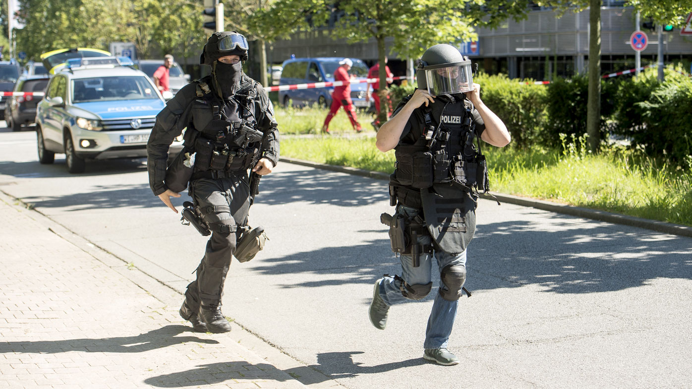 Heavily-armed police outside a movie theatre complex where an armed man has reportedly opened fire in Viernheim, Germany. (Getty)