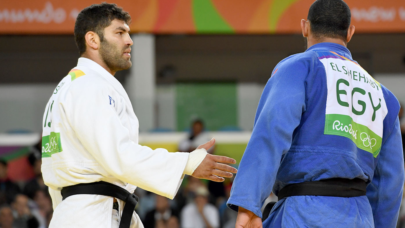 Israel's Or Sasson (white) competes with Egypt's Islam Elshehaby during their men's +100kg judo contest match of the Rio 2016 Olympic Games. (AFP)