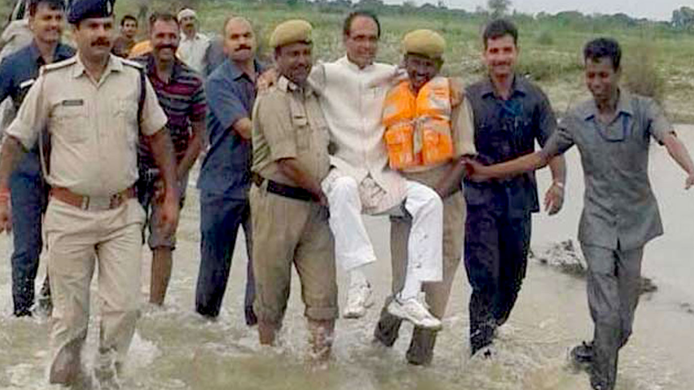 Twitter users mock Indian politician carried through floods