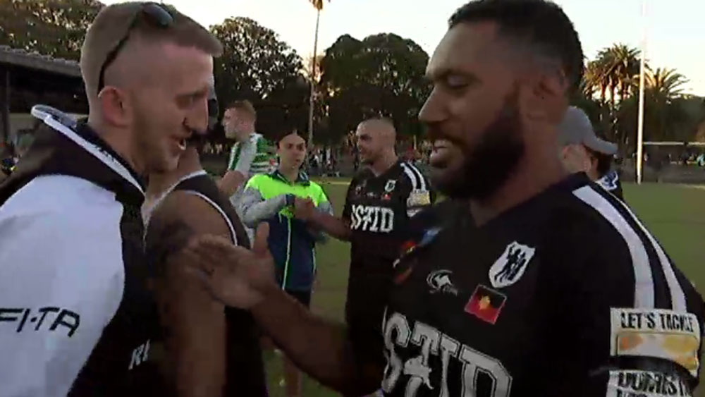 Acura 'Junior' Niuqila celebrates the All Blacks' grand final win. (ABC News)