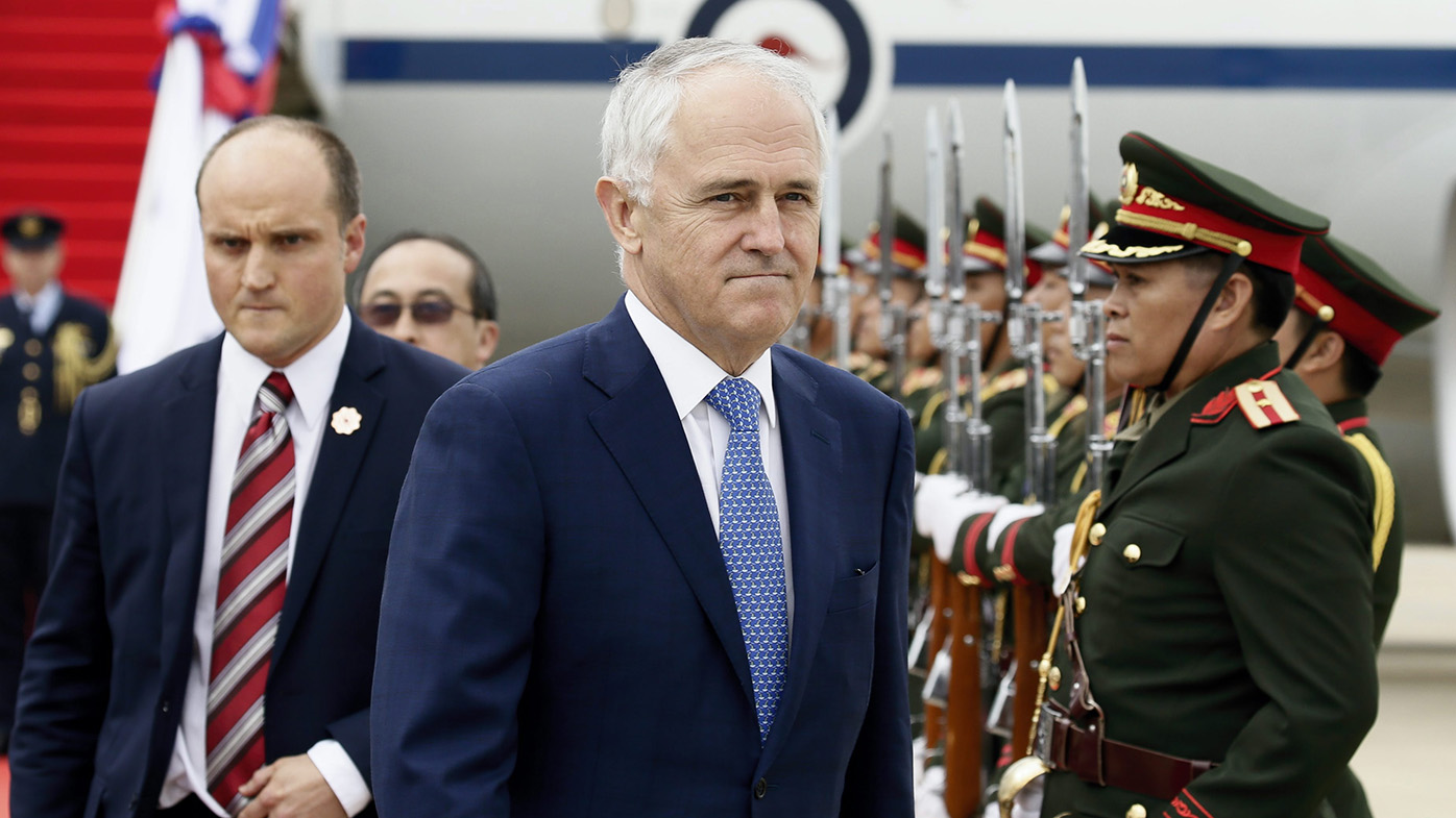 Malcolm Turnbull reviews Lao honor guards as he arrives at Wattay international airport the Association of Southeast Asian Nations (ASEAN) Summits in Vientiane, Laos. (AAP)